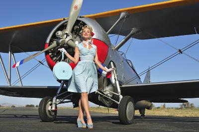 Elegant 1940's Style Pin-Up Girl Standing in Front of an F3F Biplane--Photographic Print