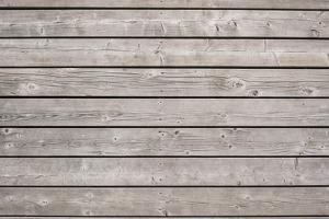 Background of Old Wooden Weathered Unpainted Deck Planks by elenathewise
