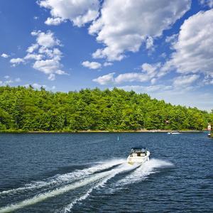 Motorboat on Summer Lake in Georgian Bay, Ontario, Canada by elenathewise