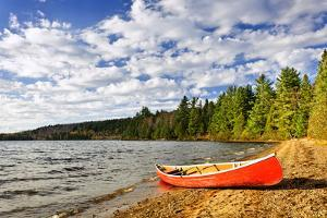 Red Canoe on Beach at Lake of Two Rivers, Ontario, Canada by elenathewise