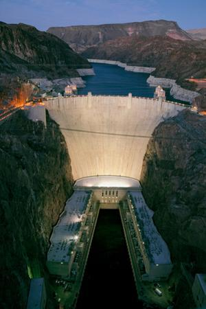 Elevated view at dusk of Hoover Dam (formerly Boulder dam) and Lake Mead is in the Black Canyon...