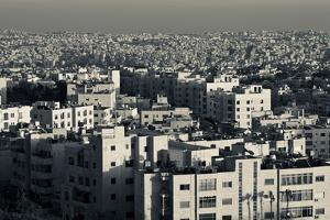 Elevated view of city and Zahran Street from the Fourth Circle at dusk, Amman, Jordan