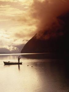 Fisherman at Sunrise, Lake Grundlsee by Elfi Kluck