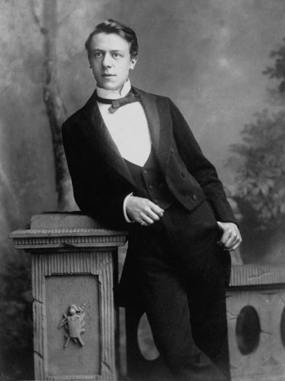 Elgant Young Man Posing for Studio Portrait Attired in Black Tie and Tails--Photographic Print