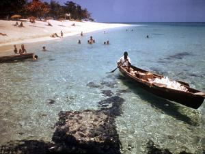 1946: Sam Cunningham Sells Sea Shells to Tourist Along the Seashore in Montego Bay, Jamaica by Eliot Elisofon