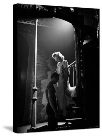 Actor Marlon Brando Kneeling before Actress Kim Hunter in Love Scene, A Streetcar Named Desire