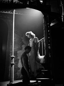 Actor Marlon Brando Kneeling before Actress Kim Hunter in Love Scene, A Streetcar Named Desire by Eliot Elisofon