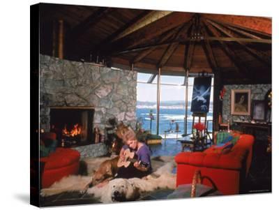 Actress Kim Novak Playing Guitar Beside Pet Great Dane Warlock at Her Home in Big Sur