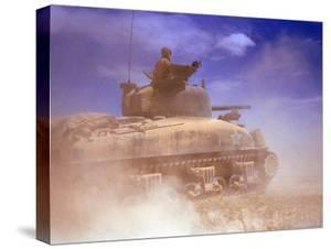American Sherman Tank on the Move After the Battle of El Guettar by Eliot Elisofon