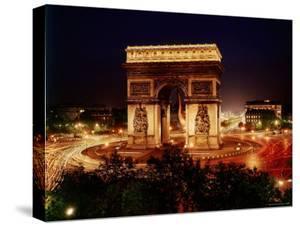 Arc de Triomphe in Place de L'Etoile at Night by Eliot Elisofon