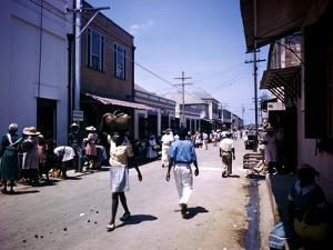 December 1946: Passersby at Market Street in Montego Bay, Jamaica by Eliot Elisofon