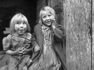 Four Year Old Flora and Her Sister Jacqueline Couch, 6 Smiling at the Camera by Eliot Elisofon