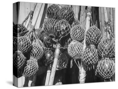 Glass Net Floats Being Used in Groups to Hold Afloat Net Markers Which Are Poles with Small Flag
