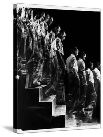 "Marcel Duchamp Walking down Stairs in exposure of Famous Painting ""Nude Descending a Staircase"""