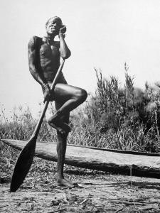 Nuer Tribesman Standing Like a Stork Next to His Canoe in a Papyrus Swamp by Eliot Elisofon
