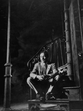 """Playwright Tennessee Williams Sitting on Theater Set of His Play """"Streetcar Named Desire"""""""