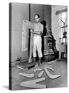 Sculptor Isamu Noguchi at Work on a Piece in His Studio by Eliot Elisofon