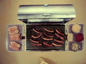 Stainless Steel Barbecue Grill, Upon Which are Buns, Hot Dogs, and Condiments, 1960 by Eliot Elisofon