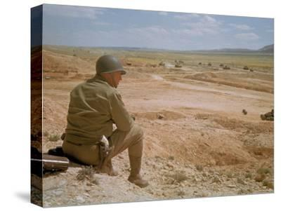 US General George S. Patton Watches Battle Between German and American Forces in El Guettar Valley