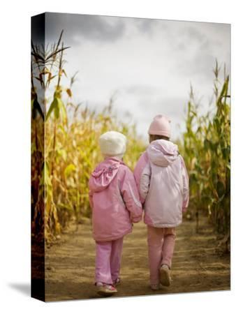 Two Children in Pink, Walking Through Cornfield