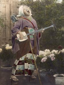 A Japanese woman sings and plays a shamisen. by Eliza R^ Scidmore