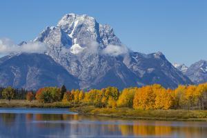 USA, Wyoming. Grand Teton National Park, fresh snowfall covers Mt. Moran on an autumn morning. by Elizabeth Boehm