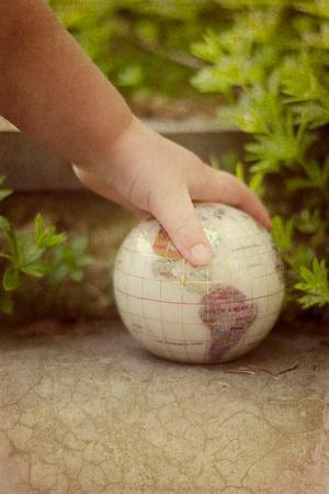 World Globe in Child's Hand