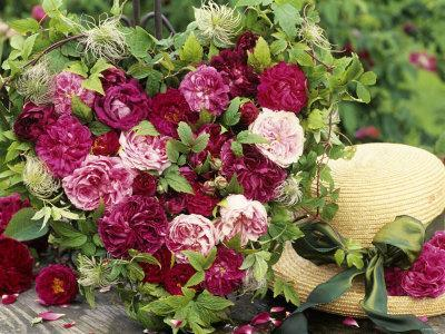 Heart Shaped Arrangement of Roses and Straw Hat