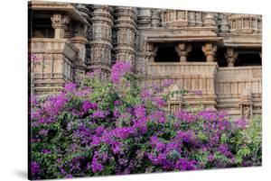 India, Madhya Pradesh State Temple of Kandariya with Bushes of Bougainvillea Flowers in Foreground by Ellen Clark