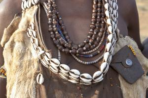 Ethiopia, Omo River Valley, South Omo, Hamer tribe. Detail of a necklace and cowrie shells by Ellen Goff