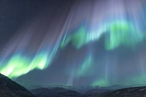 Iceland, Akureyri. The northern lights glow in unbelievable colors. by Ellen Goff