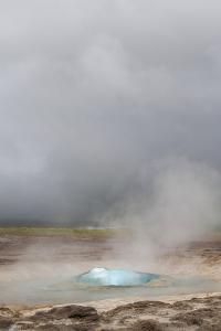 Iceland, Golden Circle. The Strokkur Geyser erupts with much steam. by Ellen Goff