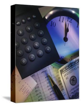 Calculator Over Clock, Spread Sheet and Money