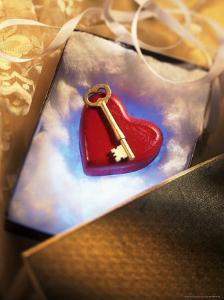 Key on Red Heart in Golden Box with Ribbon by Ellen Kamp