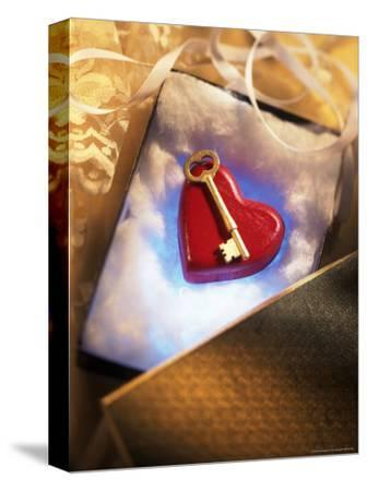 Key on Red Heart in Golden Box with Ribbon