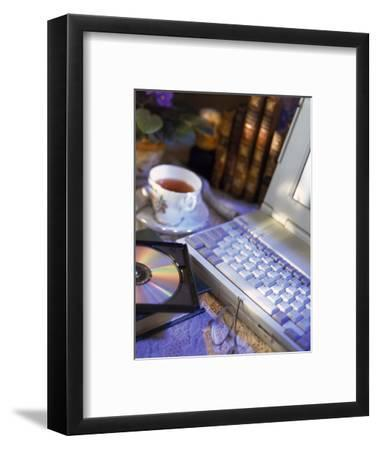 Laptop Computer, Cd-Rom, Cup of Tea, and Books