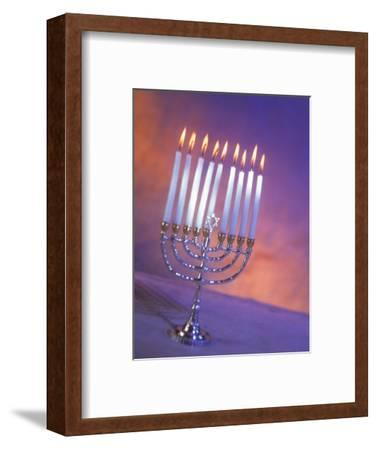 Silver Menorah with White Lighted Candles