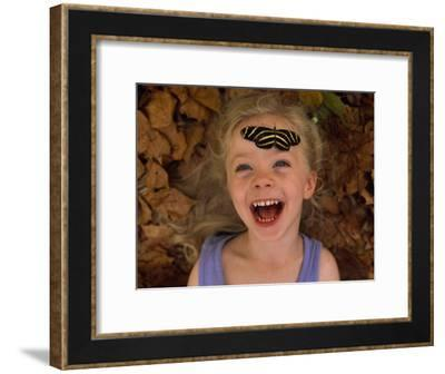 Ellen Sartore with a Zebra Butterfly Resting on Her Forehead-Joel Sartore-Framed Photographic Print