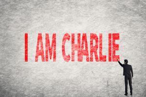 Asian Businessman Write Text on Wall, I Am Charlie by elwynn