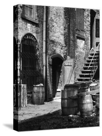 Barrels and Staircase in Alley on the Bowery, New York