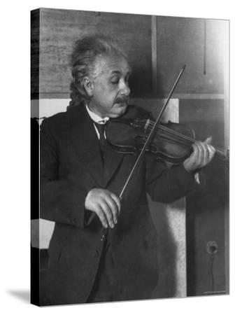 Physicist Albert Einstein Photographed by E. O. Hoppe Playing Violin