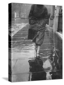 Reflections on Wet Pavement by Emil Otto Hoppé