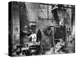 Sand Being Sifted by Worker Into Molds in Factory by Emil Otto Hoppé