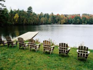 Adirondack Chairs in Row by Lake, Northeast Kingdom by Emily Riddell