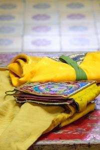 Asia, Mongolia, Ulaanbaatar, Gandantegchinlen Monastery. Cloth Prayer Booklets by Emily Wilson