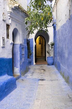 Morocco, Chaouen. Narrow Street Lined with Blue Buildings