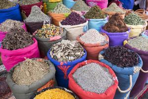 Morocco, Marrakech. Bags of Herbs, Spices and Dried Floral and Vegetable Items in the Souk by Emily Wilson