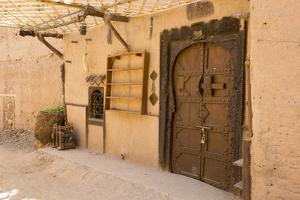 Morocco, South of Morocco, Traditionally Carved Wood Door at Tamnougalt Kasbah in the Draa Valley by Emily Wilson