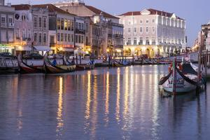 Portugal. Aveiro. 'Portuguese Venice'. Canal District Tourist Gondola and their Reflections by Emily Wilson