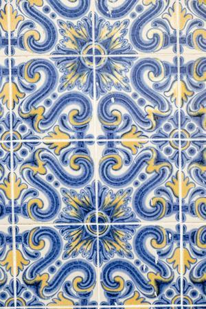 Portugal, Lisbon, Alfama District. Doorway with Blue and Yellow Tile Work